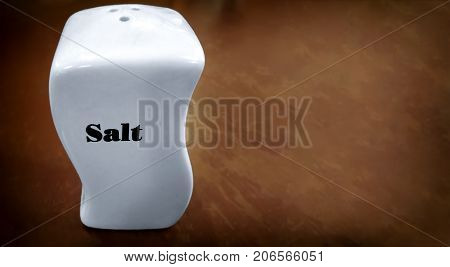White Uniquely Shaped Ceramic Salt Shaker with Black Text