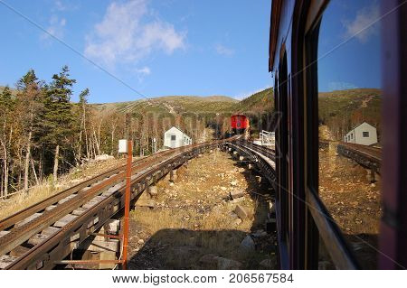 A Cog Train and rail in White Mountains in fall, New Hampshire, USA.