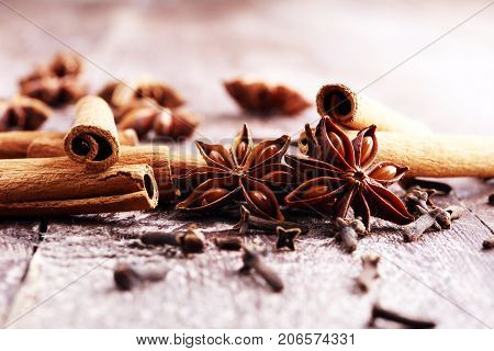 cinnamon staranise and cloves. winter spices on wooden background.