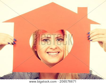 Happy Woman Holding Red Paper House