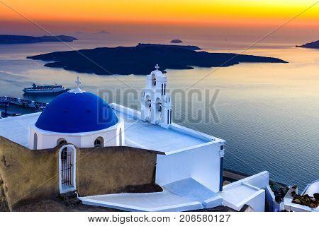 Firostefani, Santorini, Greece. twilight with old greek church and caldera at Aegean Sea - Greek Islands landmark