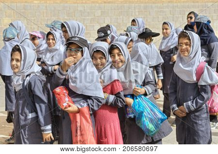 Fars Province Shiraz Iran - 19 april 2017: Iranian schoolgirls expect the beginning of the excursion at the walls of the ancient fortress.