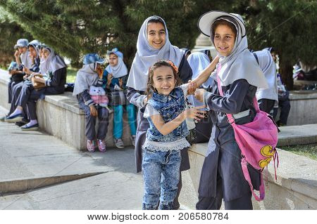 Fars Province Shiraz Iran - 19 april 2017: Iranian schoolgirls are resting in the city garden during a school excursion.