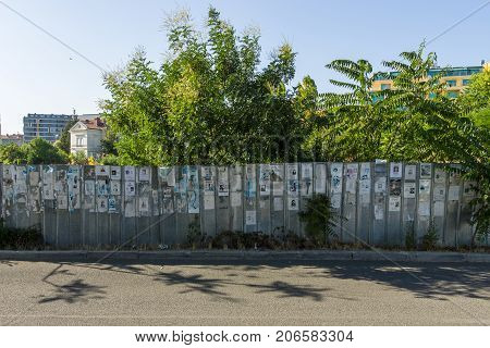BURGAS BULGARIA - AUGUST 20 2017: One of the many walls of commemoration. Unusual Bulgarian tradition (Vspomen) to commemorate the deceased - hang an obituary.