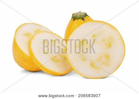Close-up picture of three slices of fresh, natural and raw yellow zucchini, isolated on a white background. A whole organic vegetable near the fresh slices of zucchini with seeds. Summer ingredients.
