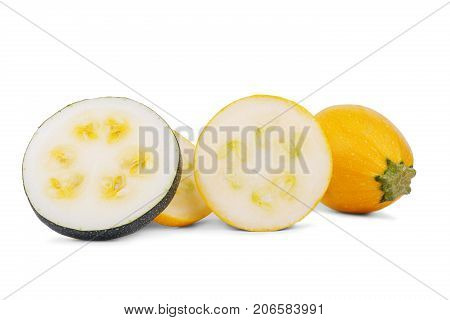 Close-up picture of perfect slices of fresh, natural, raw yellow zucchini, isolated on a white background. A whole organic vegetable near the fresh slices of zucchini with seeds. Summer ingredients.