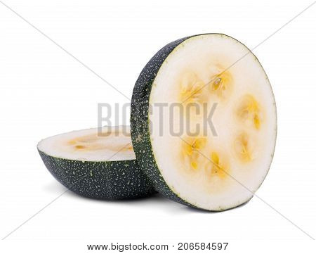 Close-up of two slices of natural and organic zucchini, isolated on a white background. Two pieces green zucchini with yellow seeds. Fresh summer vegetables for salads.
