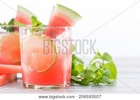 Refreshing summer drink from watermelon with lime and mint