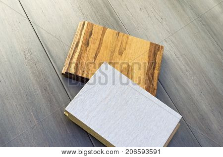 two wood floor samples tongue and groove design white oak and eucalyptus hardwood species atop bamboo wide plank floor