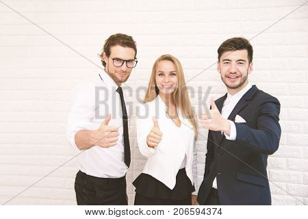 Team workers thumbs up for success in business in front of wall at cafe Business and success concept Teammate and Cooperation Soft tone pinterest and instragram like process.