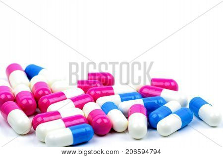 Closeup colorful of antibiotic capsules pills isolated on white background with copy space. Drug resistance antibiotic drug use with reasonable health policy and health insurance concept.