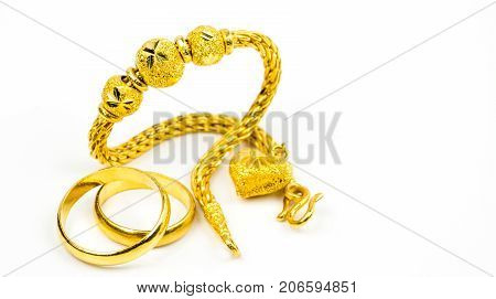 Thai style gold jewelry bracelet and couple gold ring isolated on white background with copy space just add your own text. Chinese New Year gift. Gold shop business concept