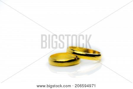 Two gold wedding ring isolated on white background with copy space just add your own text