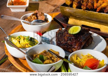 Traditional Balinese Sea Food With Satay And Curry In Bali, Indo