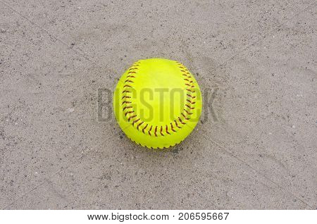 Fast or Slow Pitch Tournament Game - Dirty yellow Softball on field