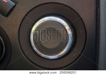 Rounded selector switch in the car. Black selector with chrome edging.