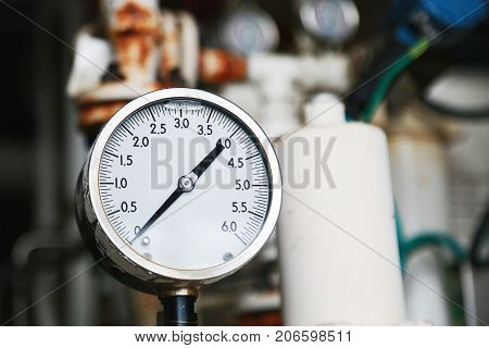 Pressure gauge using measure the pressure in production process. Worker or Operator monitoring oil and gas process by the gauge for routine record and analysis oil and gas production process.