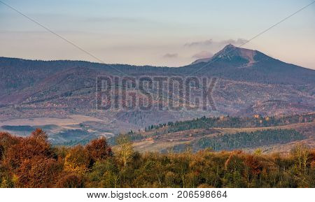 Ridge With High Peak Above Hills With Forest