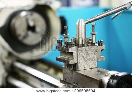 Lathe machine in a workshop and garage. Lathe machine is operation on the workshop by technician or operator. the machine for modify the object or spare part in industry job.