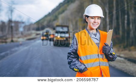 female worker road construction infrastructure repair pavement