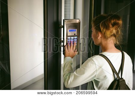 Young Blond Teenager Schoolgirl Dials The Code For A Call Over The Intercom
