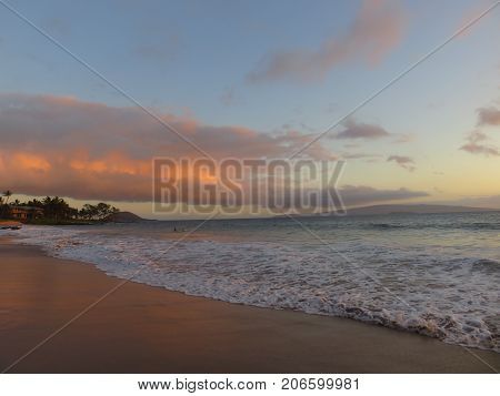 Spectacular Red, Orange and Yellow Tropical Sunset over the Pacific Ocean at Polo Beach Park, Wailea, Maui, Hawaii