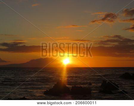 Spectacular Red, Orange and Yellow Tropical Hawaiian Sunset over the  Pacific Ocean at Polo Beach Park, Wailea, Maui, Hawaii