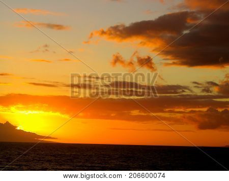 Spectacular Yellow, Orange and Red Tropical Sunset over the  Pacific Ocean at Polo Beach Park in Wailea, Maui, Hawaii