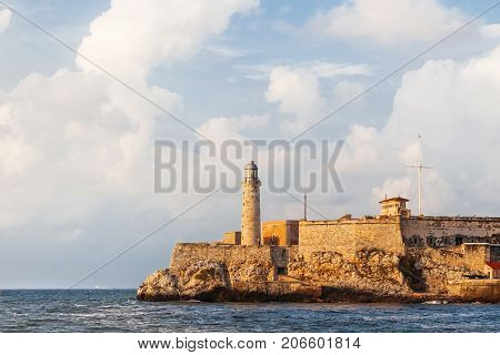 Fortress and lighthouse of El Morro in the entrance of Havana bay Cuba. Sunset after storm.