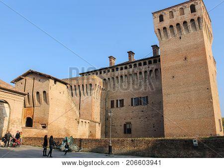 Vignola Italy - October 30 2016: Tourists near impressive ancient fortress. Emilia-Romagna Modena