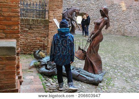 Vignola Italy - October 30 2016: Tourists near decorative sculptural installations in ancient fortress. Emilia-Romagna Modena