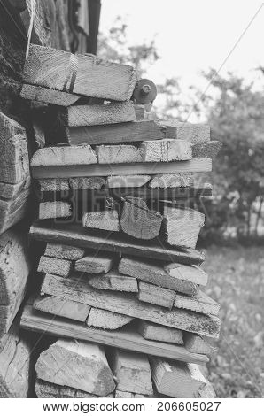 Monochrome photo of the fire wood in the village