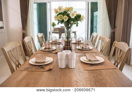 Wooden dining table setting in the dining room.