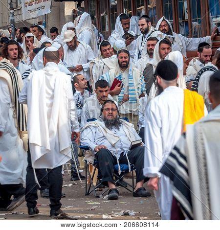 Mass prayer. Hasids pilgrims in traditional clothes. Uman Ukraine - September 21 2017: Rosh-ha-Shana festival Jewish New Year.