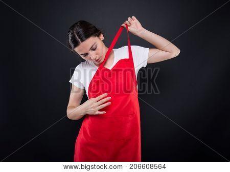 Female Seller Adjusting Her Apron