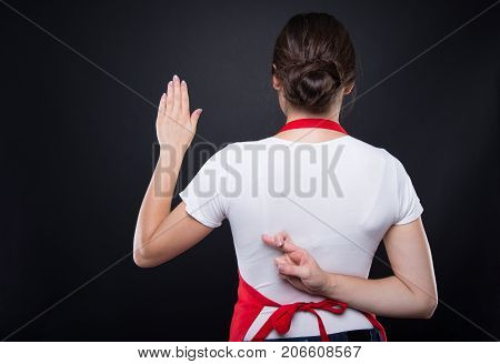 Beautiful Woman With Fingers Crossed Behind Her Back
