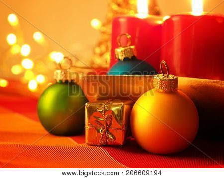 Colorful Christmas background with decoration selective focus on a golden gift box