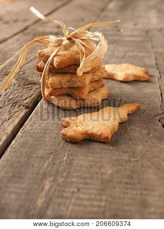 Sweet organic homemade cookies on an old rustic kitchen table