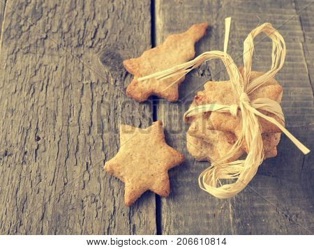 Sweet organic homemade cookies on an old rustic kitchen table vintage color stylized view from above
