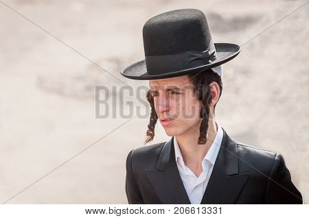 Young hasid pilgrim in the crowd on the city street. Uman Ukraine - 21 September 2017: holiday Rosh Hashanah Jewish New Year.