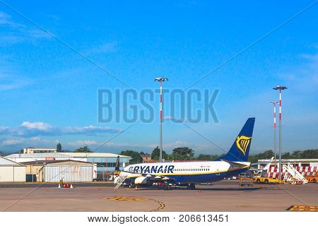 Bologna, Italy - June 30, 2017: Ryanair blue commercial airplane parked at Bologna airport BLQ, with blue sky and copy space. Ryanair is main european low cost flights company.