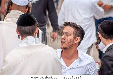 Young hasids pilgrims in the crowd on the city street. Uman Ukraine - 21 September 2017: holiday Rosh Hashanah Jewish New Year.