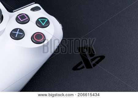 Sankt-Petersburg Russia September 24 2017: Sony PlayStation 4 Slim 1Tb and dualshock game controller. Game console with a joystick. Home video game console