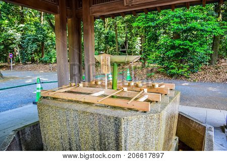 TOKYO, JAPAN - MAY 15: Original Japanese dipper water blessing and pray for good health and happiness located in Meiji Shrine, Shibuya, Tokyo