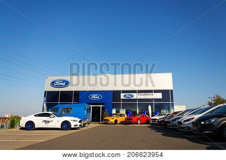 Prague, Czech Republic - September 29: Cars In Front Of Ford Motor Company Dealership Building On Se