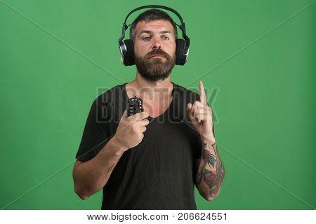 Dj With Beard Wears Headphones, Copy Space. Music And Leisure