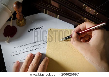 Notary Signing A Contract With Fountain Pen.