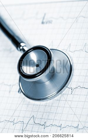 Close Up View Of Stethoscope On Electrocardiogram Background.