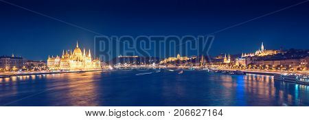 Budapest night panorama with Parliament and Buda Castle above Danube river in Hungary