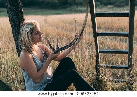 Woman with antler resting outdoor